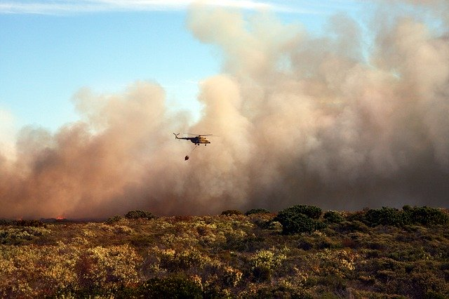 Helicopter extinguishing fire
